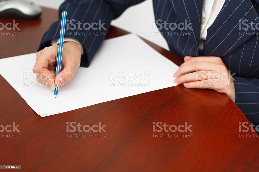 Businesswoman write with pen royalty-free stock photo