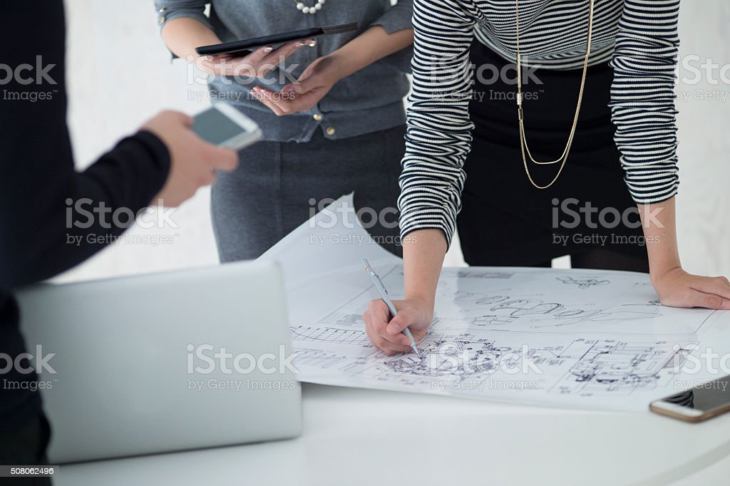 Businesswoman writing a drafting stock photo