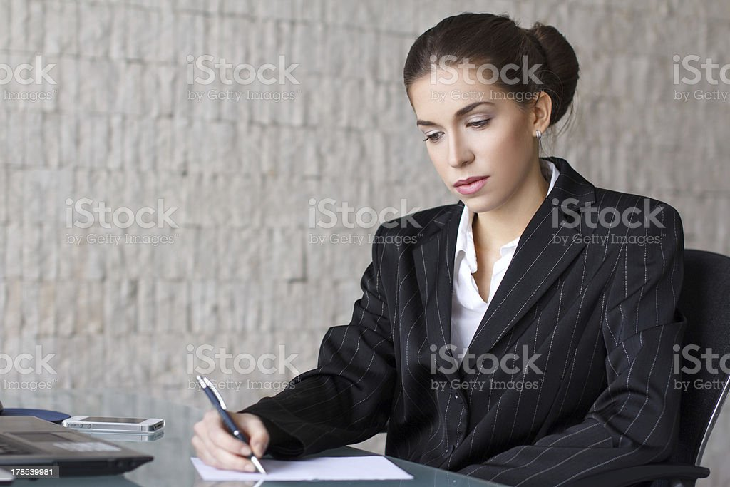 Businesswoman writing letter royalty-free stock photo