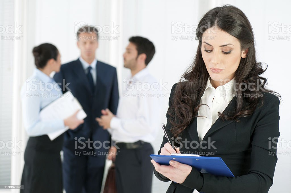 Businesswoman writing on a clipboard at a job interview  stock photo