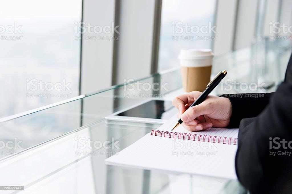 Businesswoman writing something stock photo