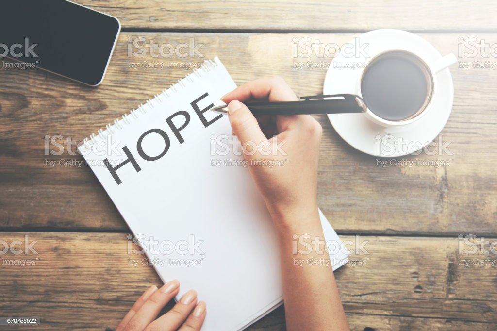 Businesswoman Writing the Word 'Hope' stock photo