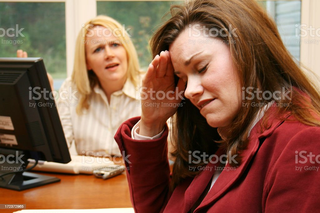 Businesswoman yelling at another upset businesswoman royalty-free stock photo