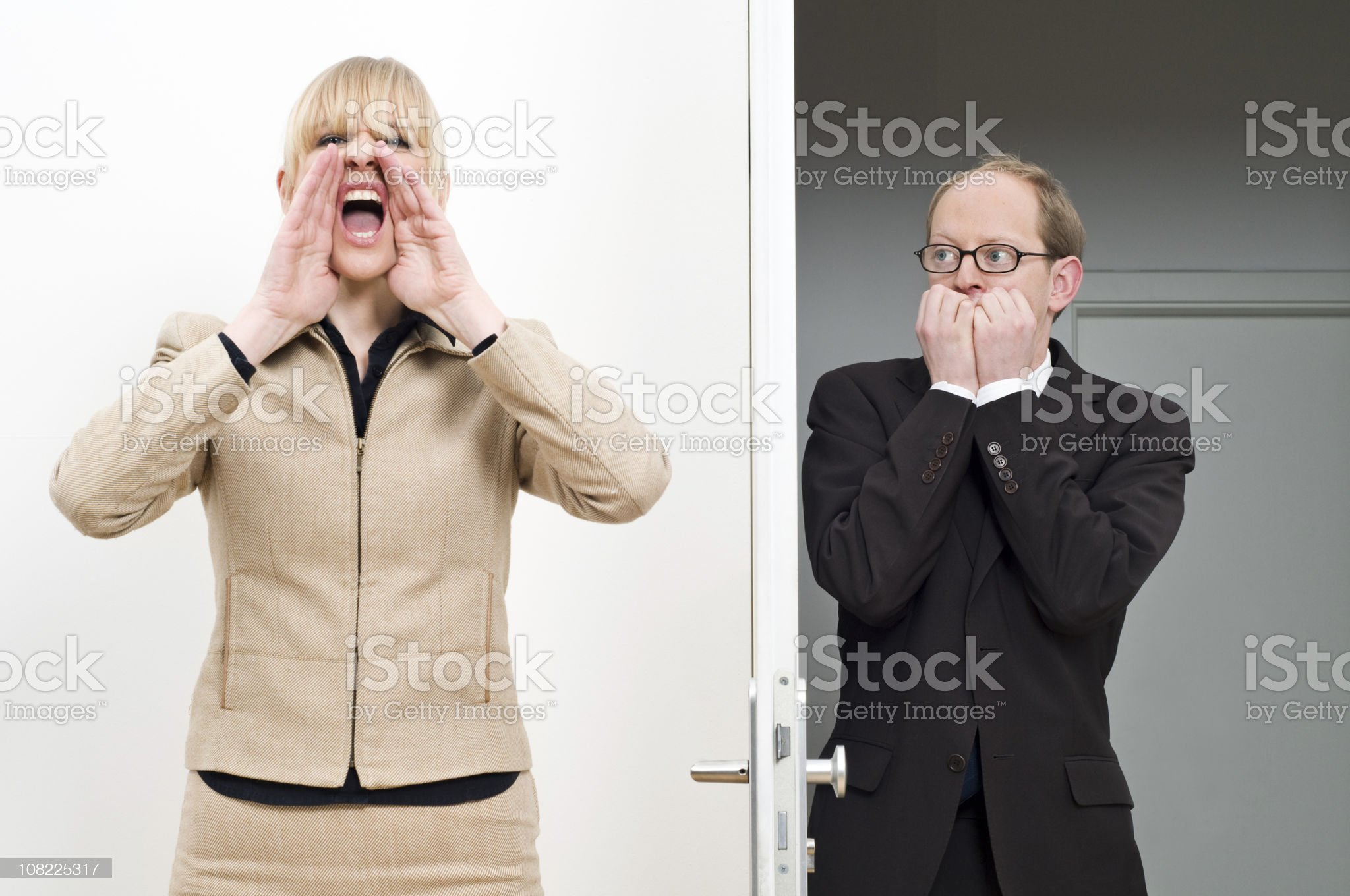 Businesswoman Yelling For Scared Businessman royalty-free stock photo