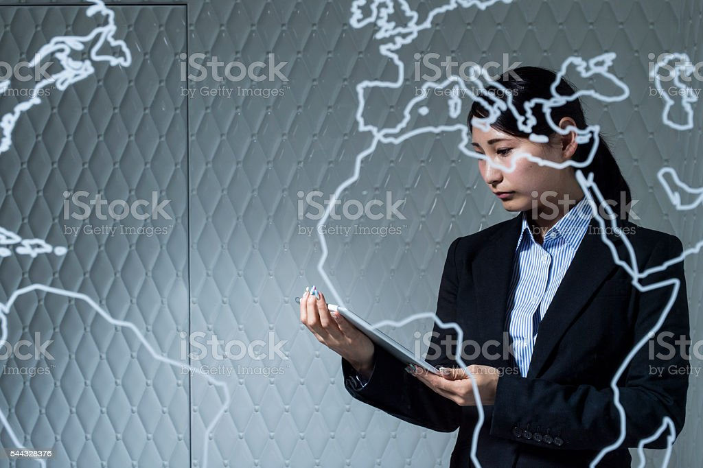 Businesswoman you are using a tablet in the office stock photo