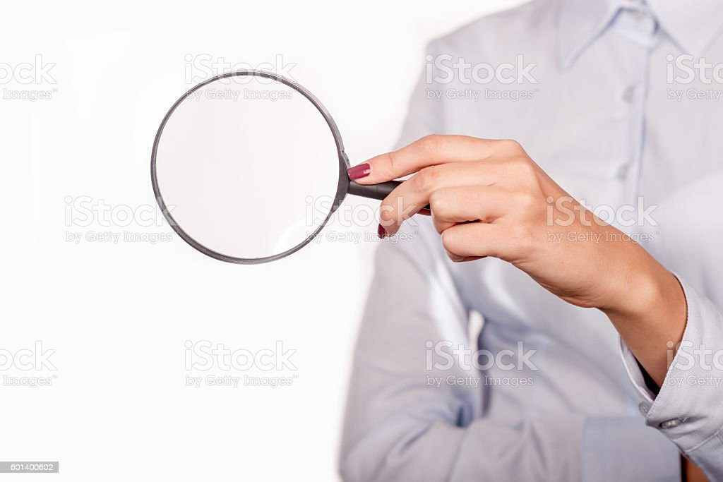 Businesswoman's hand, holding classic styled magnifying glas. White background stock photo