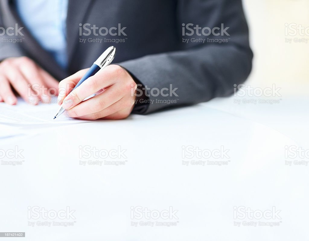 Businesswoman's hands signing a contract royalty-free stock photo