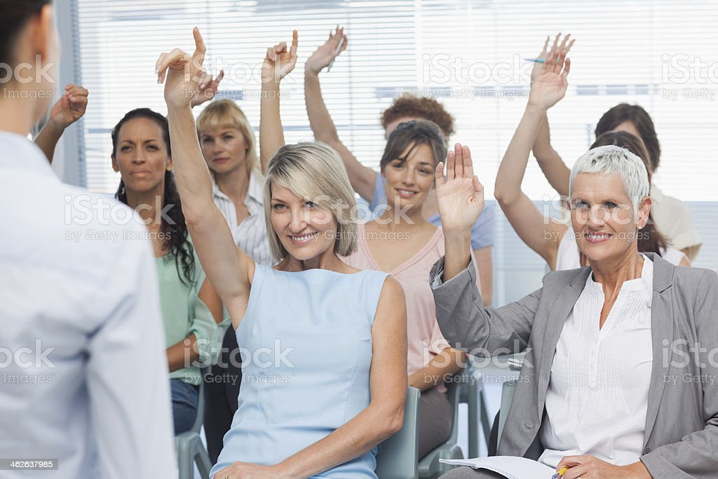 Businesswomen asking questions stock photo