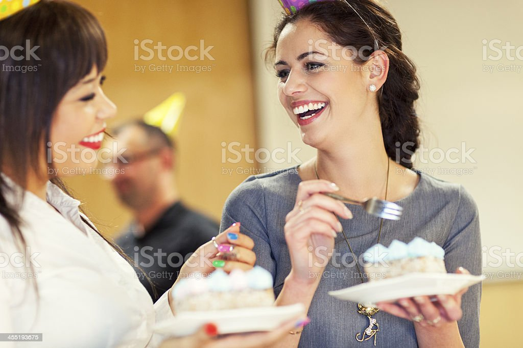 Businesswomen At Office Party stock photo