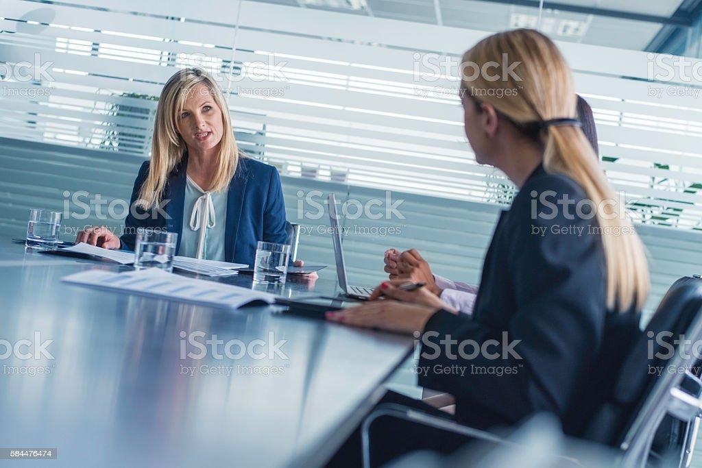 Businesswomen attending a meeting stock photo