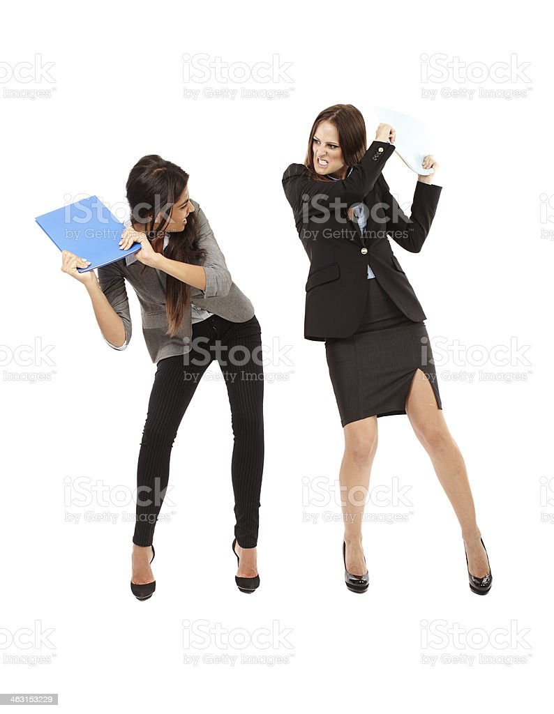Businesswomen beating each other stock photo