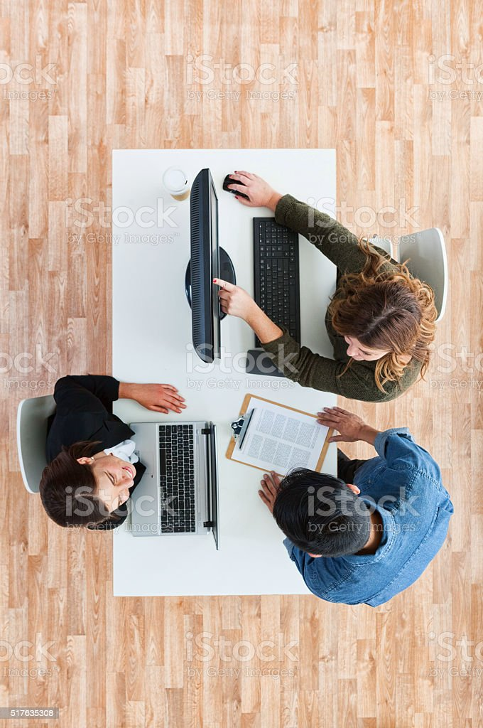 Businesswomen discussion with client stock photo