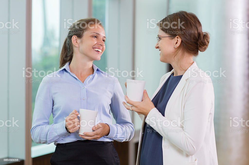 Businesswomen Drinking Tea in Office stock photo