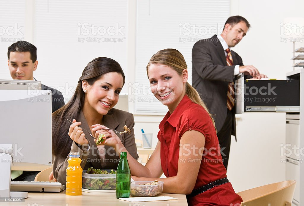 Businesswomen Eating Salad for Lunch royalty-free stock photo