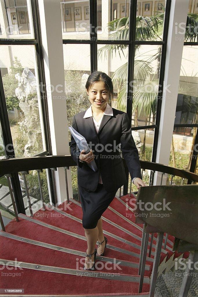 businesswomen holding folder walking on stair royalty-free stock photo