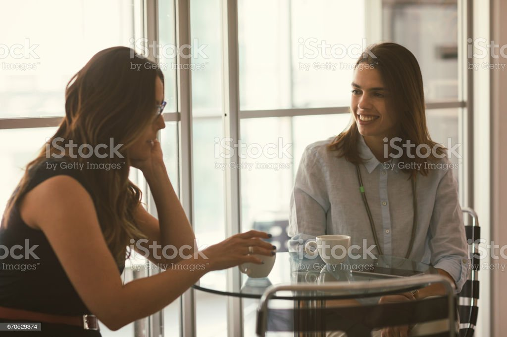 Businesswomen in cafe stock photo