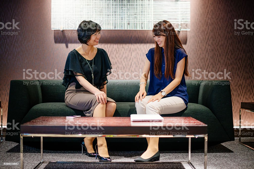 Businesswomen in Japanese company discussing new investments stock photo