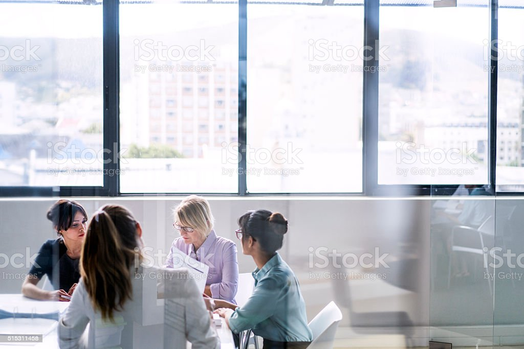 Businesswomen in meeting at office stock photo