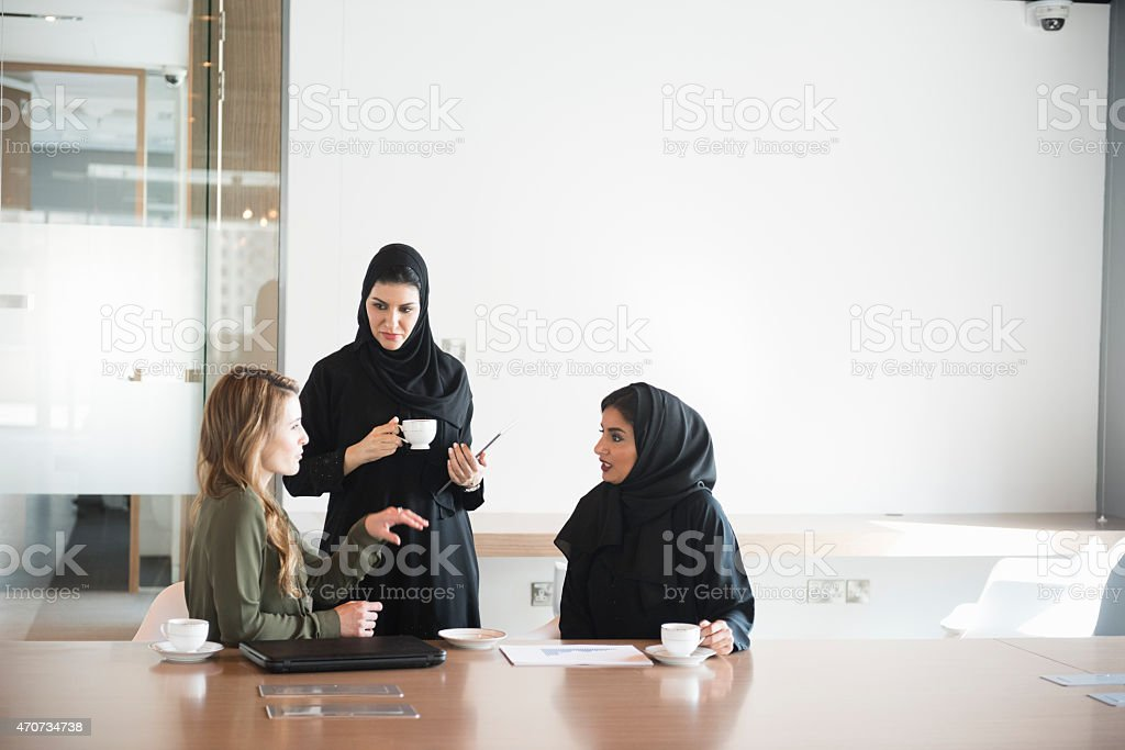 Businesswomen in Middle East office meeting stock photo