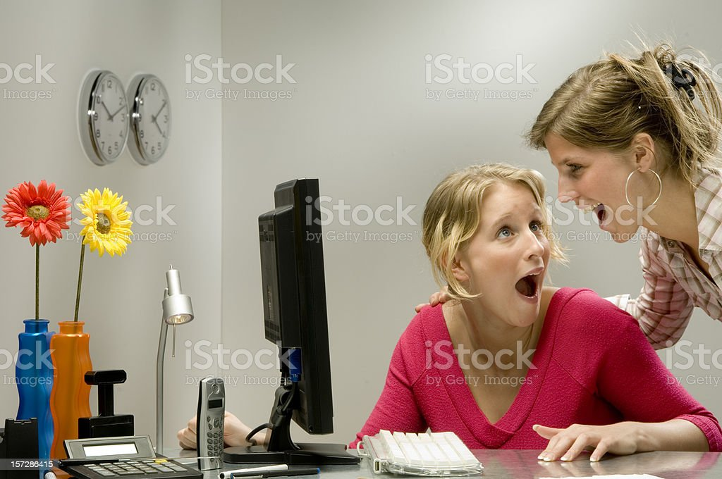 businesswomen screaming in the office royalty-free stock photo