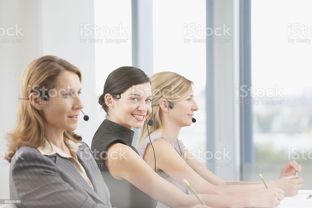 Businesswomen talking on headsets royalty-free stock photo