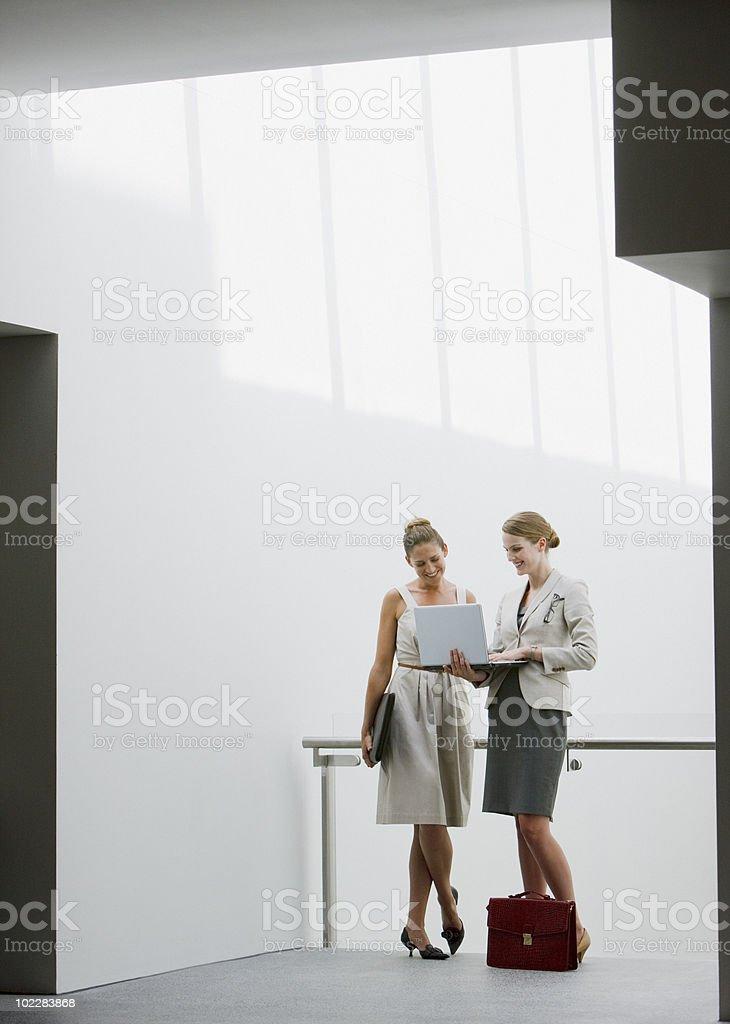 Businesswomen talking outdoors royalty-free stock photo