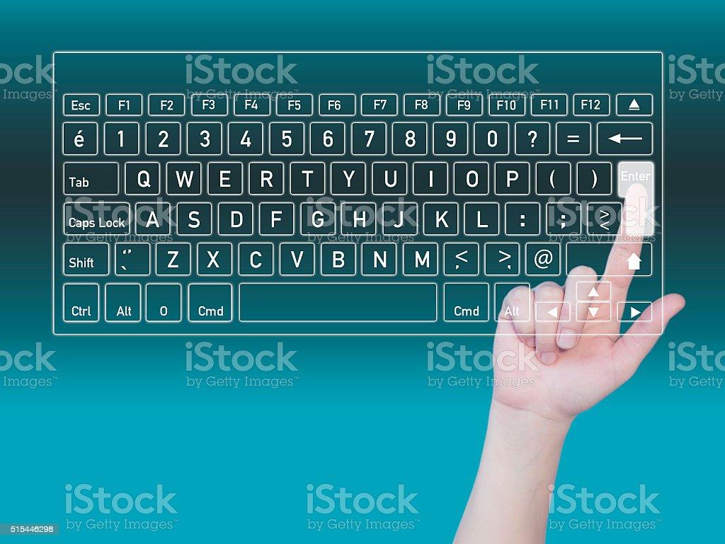 Businesswomen touching enter key stock photo