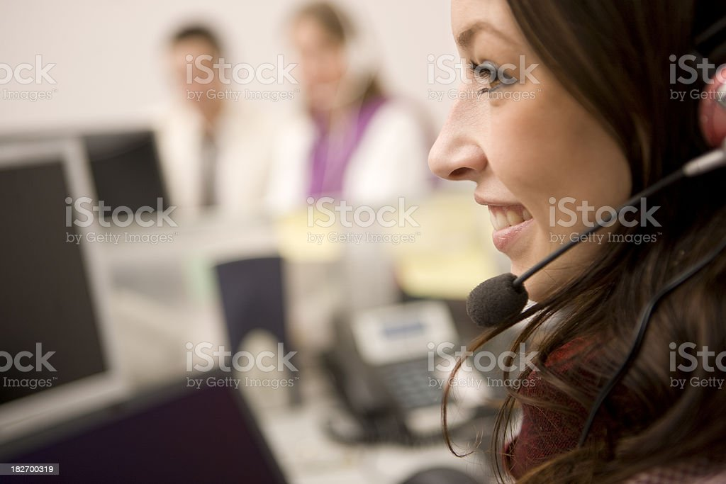 Businesswomen using headset royalty-free stock photo