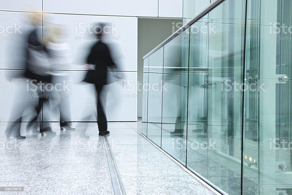 Businesswomen Walking in Modern Office Building stock photo
