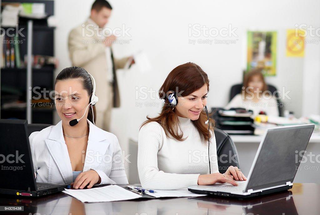 Businesswomen working in headsets . stock photo
