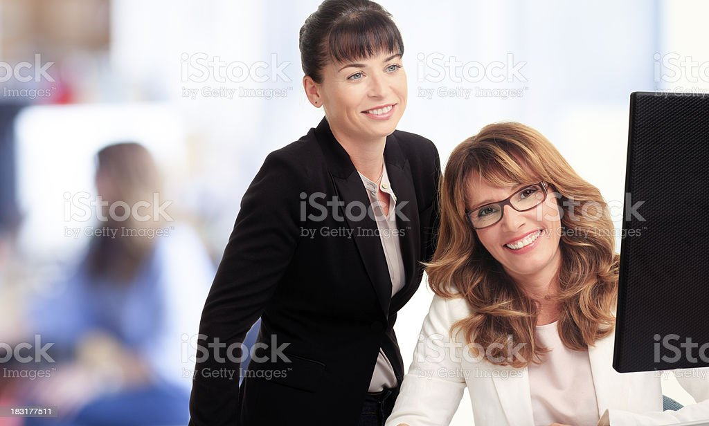 Businesswomen working in office royalty-free stock photo
