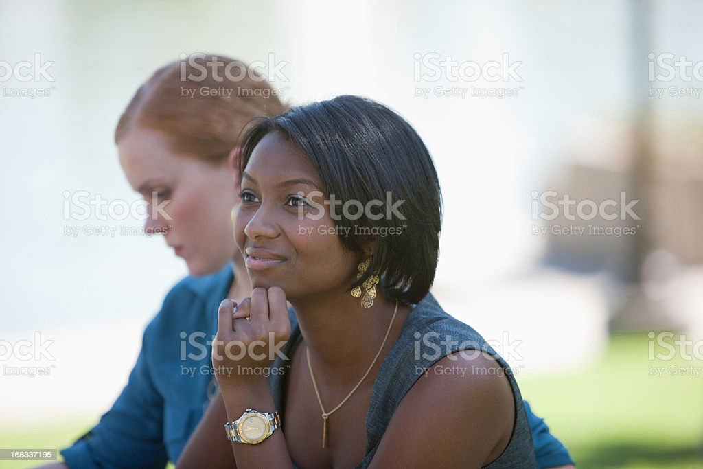 Businesswomen working in park royalty-free stock photo