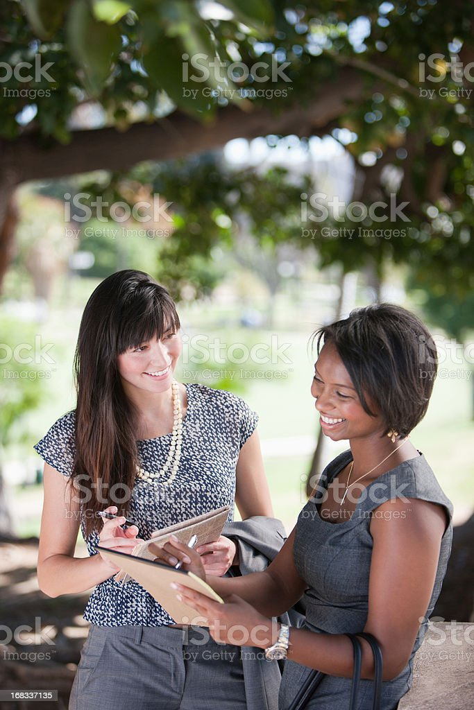Businesswomen working together in park royalty-free stock photo