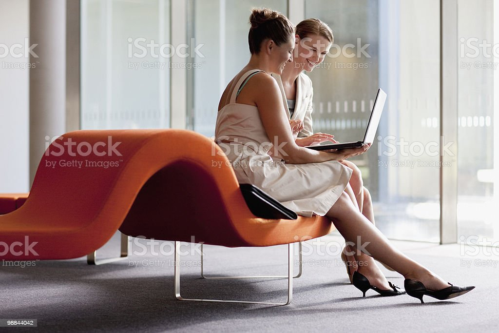 Businesswomen working with laptop in waiting area stock photo