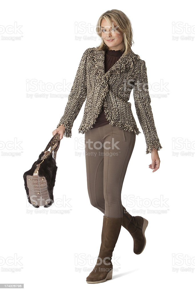 Busineswoman Walking with A Purse Isolated On White Background royalty-free stock photo