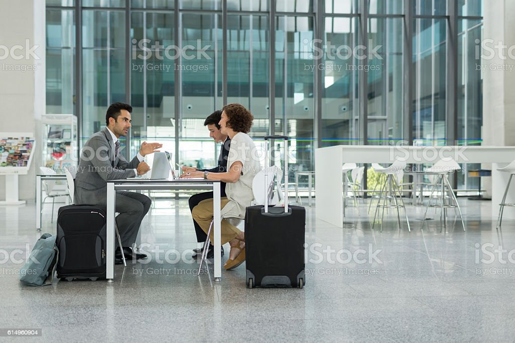 Businss meeting in airport's terminal before traveling. stock photo