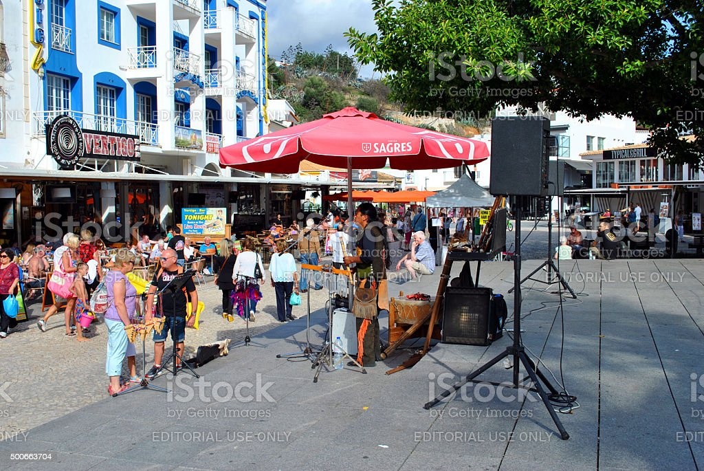 Busker in the old town of Albufeira, Portugal stock photo