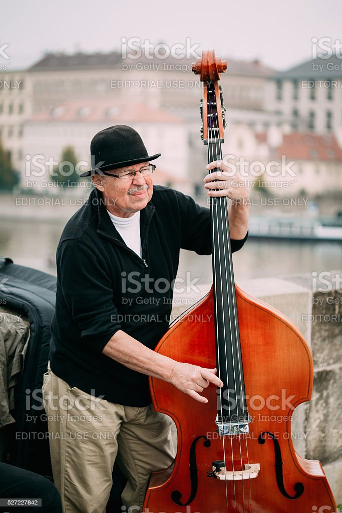 Busker performing jazz songs at the Charles Bridge in Prague stock photo