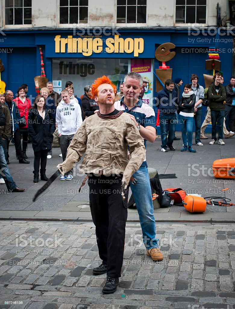 Busker performs with crowd at the Edinburgh Fringe festival stock photo