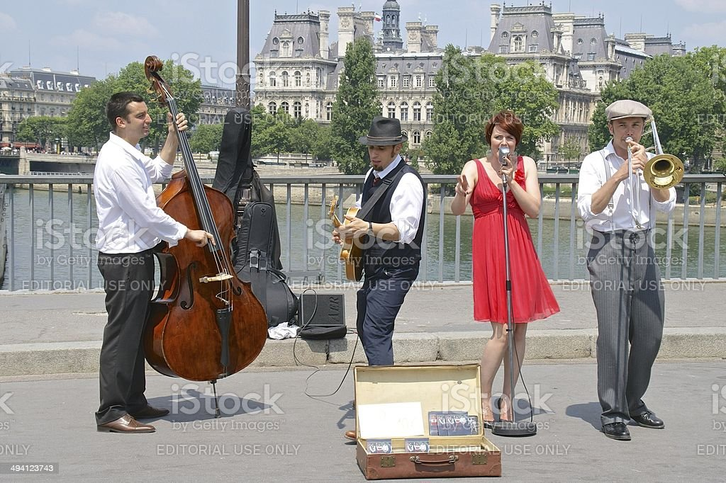 Buskers on the Pont St Louis, against a Paris backdrop royalty-free stock photo