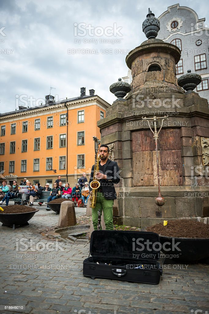 Busking with saxaphone in Stortorget Square, Stockholm, Sweden stock photo