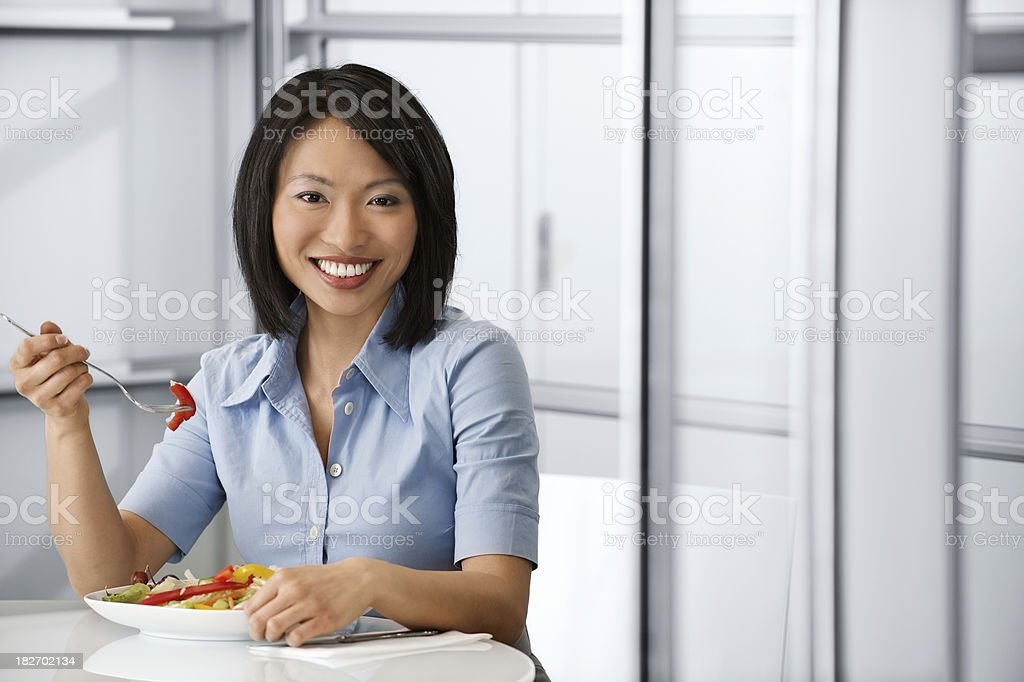 Busness woman eating a healthy lunch royalty-free stock photo
