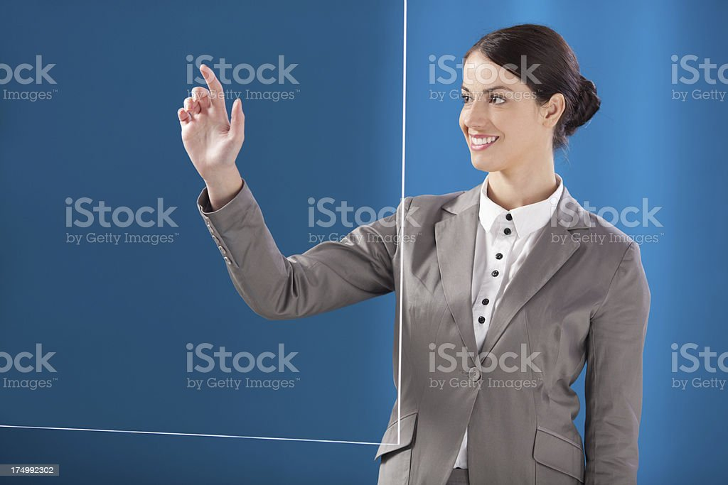Busness woman working on transparent monitor stock photo