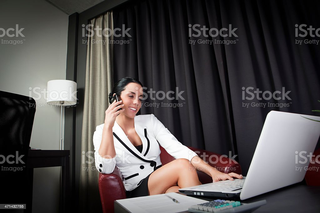 Busniess woman on the phone and writing royalty-free stock photo