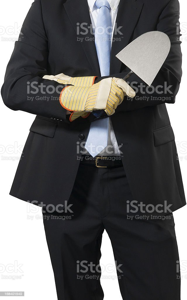 busniessman with a trowel stock photo