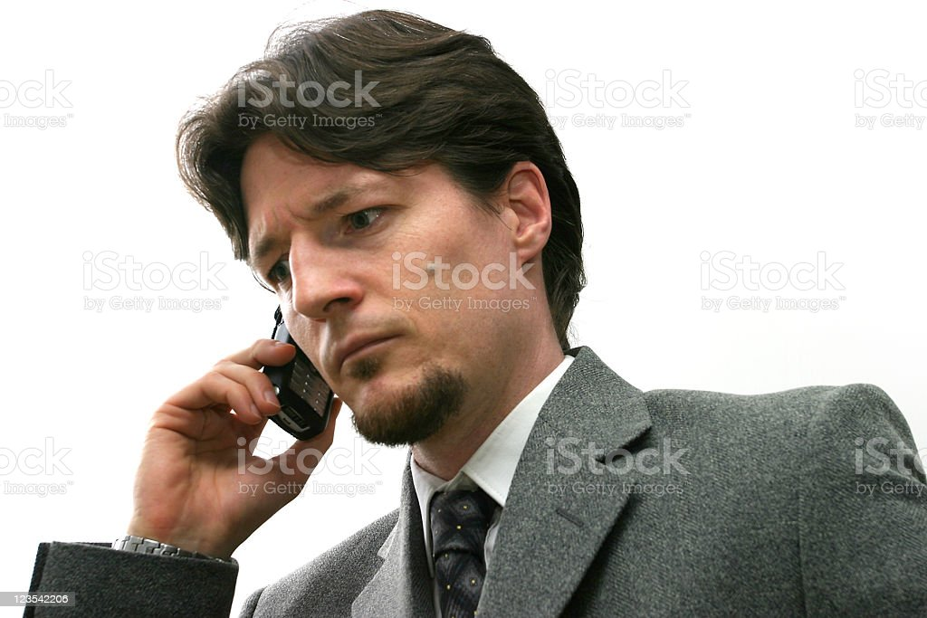 Busnissmen on the phone - worried royalty-free stock photo