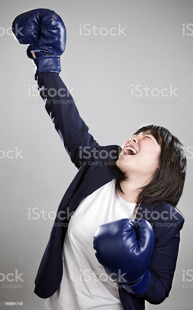 Bussines woman in boxing gloves royalty-free stock photo