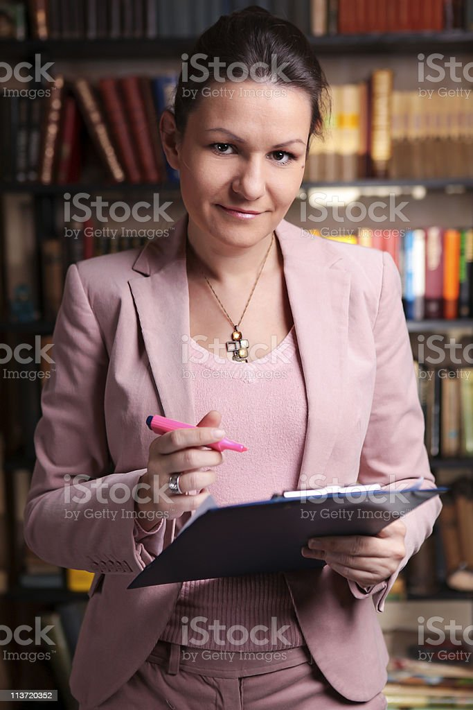 bussines woman in pink suit stock photo