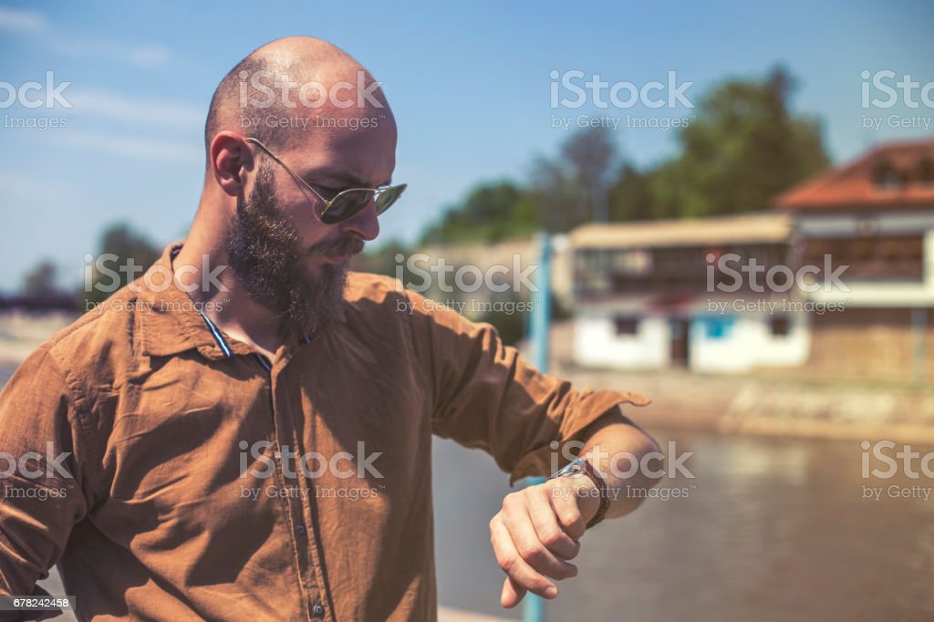 Bussinesman checking the time on watch stock photo