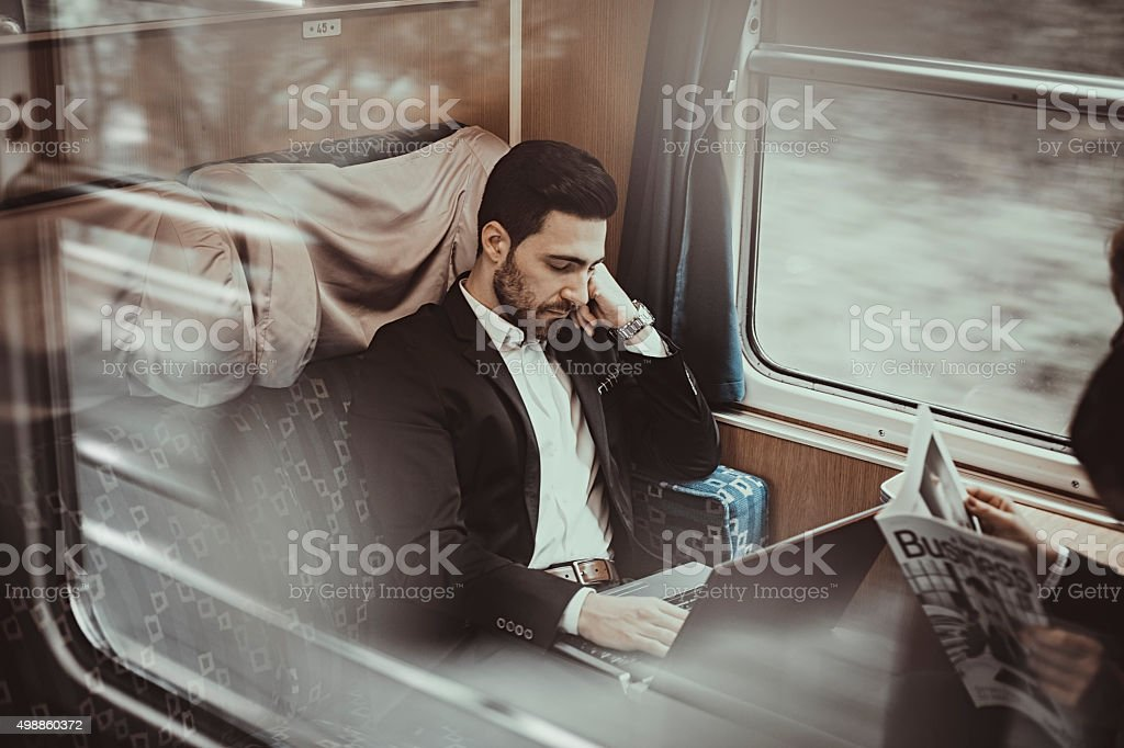 bussinesman  relaxing on the passenger train stock photo